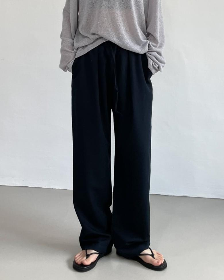 reverse wide banding trousers