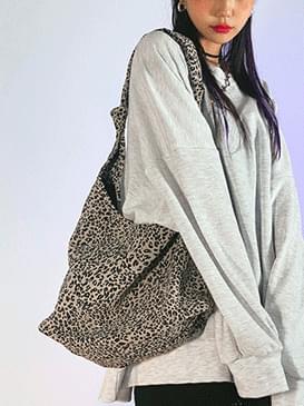 leopard with shoulder bag