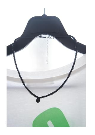 black symbol necklace