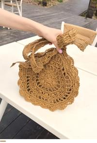 Rounded rattan bag