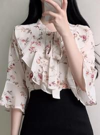 Polka-dotted blouse