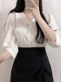 Two-pocket ruffle blouse