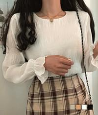 Della ruched sleeve ruffled blouse