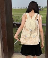 four quilted backpack
